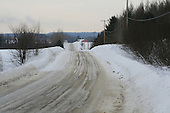 snow covered winter road in country