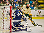 4 January 2014:  Yale University Bulldog goaltender Alex Lyon, a Freshman from Baudette, MN, makes a second period blocker save against the University of Vermont Catamounts at Gutterson Fieldhouse in Burlington, Vermont. With an empty net and seconds remaining, the Cats came back to tie the game 3-3 against the 10th seeded Bulldogs. Mandatory Credit: Ed Wolfstein Photo *** RAW (NEF) Image File Available ***