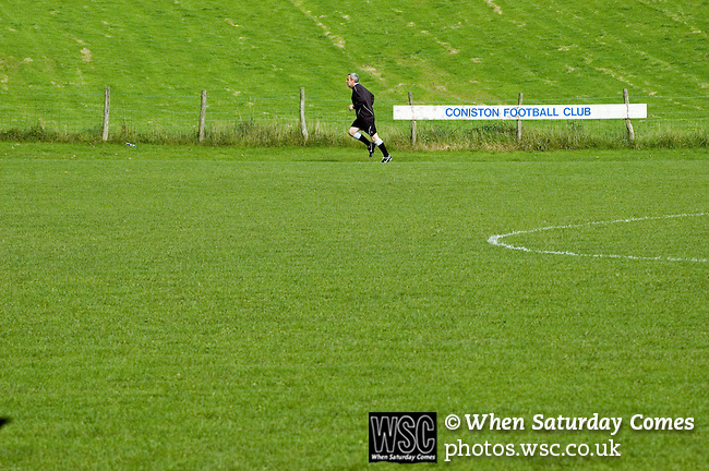 Coniston v Penrith, 20/09/2008. Westmorland League. The referee warming up. Photo by Paul Thompson.