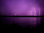 Rain falling on the James River with lightning storm over historic Jamestown Island. Site of the first permanent English settlement in the New World, established in 1607, Virginia. This view is from the Colonial Parkway in the Colonial National Historical Park (U.S. National Park Service,) in Virginia's &quot;Historic Triangle&quot; (Jamestown-Williamsburg-Yorktown.)