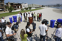 Tuesday, May 12, 2009.  Mission Beach, San Diego, CA, USA.  Mayor Jerry Sanders addresses the media as District 2 councilmember Kevin Faulconer, Eviromental Services Dierector Chris Gonaver and members of the commuinity look on.  Faulconer announced today that he plans to use $80K of discretionary funds to continue a long-standing program of supplemental trash pick-ups from residents in Mission Beach during the summer months.