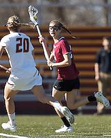 Harvard University midfielder Audrey Todd (21) looks to pass.