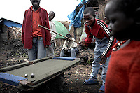 Displaced children play pool on a home made table in the Mugunga 2 IDP site, in Goma, DRC.