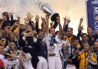 CARSON, CA - DECEMBER 01, 2012:   Landon Donovan (10) of the Los Angeles Galaxy with the trophy after beating the Houston Dynamo during the 2012 MLS Cup at the Home Depot Center, in Carson, California on December 01, 2012. The Galaxy won 3-1.