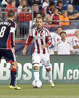 Chivas USA substitute midfielder Laurent Courtois (16) brings the ball forward. In a Major League Soccer (MLS) match, the New England Revolution tied Chivas USA, 3-3, at Gillette Stadium on August 29, 2012.
