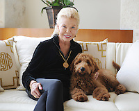 MANALAPAN, FL - JANUARY 14: Lois Pope poses for a portrait with her dog Patton at her home on January 14, 2017 in Manalapan , Florida. Credit: mpi04/MediaPunch NO NEW YORK DAILIES