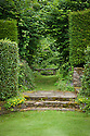 Stone seat and entrance through hedge to the Nuttery from the Bowling Lawn, Upton Grey, mid July.