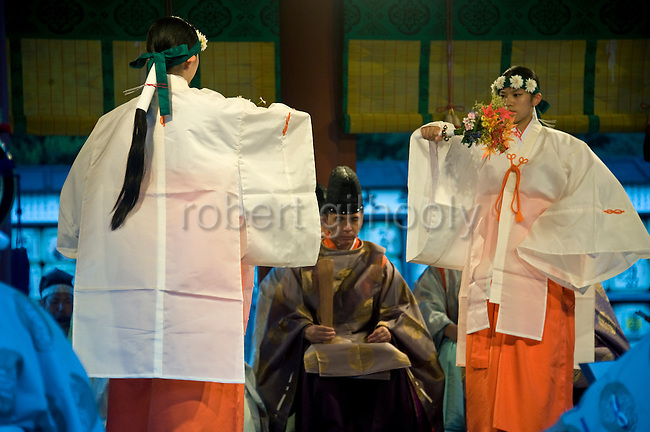 Maiko shrine attendants perform a dance during the annual Reitaisai Grand Festival at Tsurugaoka Hachimangu Shrine in Kamakura, Japan on  14 Sept. 2012.  Sept 14 marks the first day of the 3-day Reitaisai festival, which starts early in the morning when shrine priests and officials perform a purification ritual in the ocean during a rite known as hamaorisai and limaxes with a display of yabusame horseback archery. Photographer: Robert Gilhooly