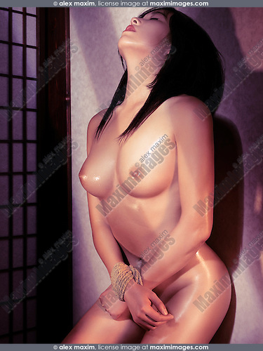 Beautiful Naked Japanese Woman With Her Hands Tied Rope Leaning