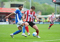 Lincoln City's Alex Woodyard vies for possession with Macclesfield Town's Rhys Browne<br /> <br /> Photographer Chris Vaughan/CameraSport<br /> <br /> Vanarama National League - Lincoln City v Macclesfield Town - Saturday 22nd April 2017 - Sincil Bank - Lincoln<br /> <br /> World Copyright &copy; 2017 CameraSport. All rights reserved. 43 Linden Ave. Countesthorpe. Leicester. England. LE8 5PG - Tel: +44 (0) 116 277 4147 - admin@camerasport.com - www.camerasport.com