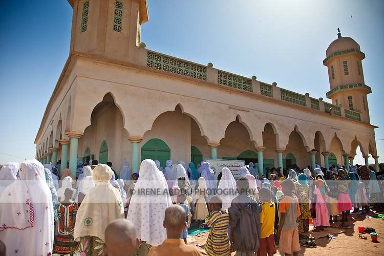 On the morning of Tabaski, men, women, and children alike converge on the great mosque of Djibo in northern Burkina Faso for a special Tabaski prayer.  This part of the country is primarily Muslim, inhabited mainly by the Fulani and Touareg, both traditionally pastoralist ethnic groups, crisscrossing the Sahel and Sahara with their cattle and other livestock, in search of green pastures and fresh water.