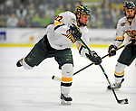 10 January 2009: University of Vermont Catamount defenseman Josh Burrows, a Sophomore from Prairie Grove, IL, takes a shot against the Boston College Eagles in the second game of a weekend series at Gutterson Fieldhouse in Burlington, Vermont. The Catamounts rallied from an early 2-0 deficit to defeat the visiting Eagles 4-2. Mandatory Photo Credit: Ed Wolfstein Photo