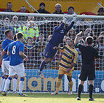 Neil Alexander scoops the ball over the net to thwart Forres