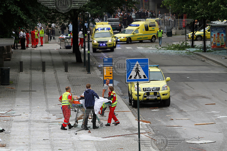 (July22,2011) A person is treated for injuries received after a large vehicle bomb was detonated near the offices of Norwegian Prime Minister Jens Stoltenberg on 22 July 2011. Although Stoltenberg was reportedly unharmed the blast resulted in several injuries and deaths. <br />