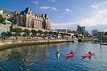 Kayking in Victoria's inner harbor with the promenade and famous Empress Hotel in the background