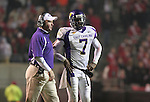"25 November 2006: East Carolina head coach Louis ""Skip"" Holtz (l) with quarterback Daniel Evans (7). The East Carolina University Pirates defeated the North Carolina State University Wolfpack 21-16 at Carter Finley Stadium in Raleigh, North Carolina in an NCAA Division I College Football game."