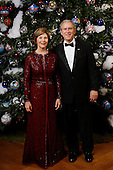 Washington, D.C. - December 9, 2008 -- United States President George W. Bush and first lady Laura Bush pose for their 2008 holiday portrait Sunday, December 7, 2008, in the Blue Room of the White House..Credit: Eric Draper - White House via CNP.