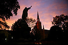 Jesus Statue on main quad with Basilica in the background.<br /> <br /> Photo by Matt Cashore/University of Notre Dame