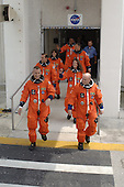 Kennedy Space Center, FL - August 8, 2007 -- The STS-118 crew stride out of the Operations and Checkout Building eager to get to Launch Pad 39A for launch of Space Shuttle Endeavour at 6:36 p.m. EDT on Wednesday, August 8, 2007. Leading the way are (left and right) Pilot Charlie Hobaugh and Commander Scott Kelly. Behind them, clockwise, are Mission Specialists Rick Mastracchio, teacher-turned-astronaut Barbara Morgan, Alvin Drew, Dave Williams and Tracy Caldwell. Williams represents the Canadian Space Agency. The STS-118 mission is the 22nd shuttle flight to the International Space Station. It will continue space station construction by delivering a third starboard truss segment, S5, and other payloads such as the SPACEHAB module and the external stowage platform 3. The 11-day mission may be extended to as many as 14 depending on the test of the Station-to-Shuttle Power Transfer System that will allow the docked shuttle to draw electrical power from the station and extend its visits to the orbiting lab. .Credit: Kim Shiflett - NASA via CNP