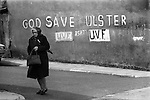 Londonderry Northern Ireland  Derry   1979. UVF Ulster Volunteer Force political graffiti on wall. Senior woman with Protestant area of Londondery.