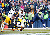 Thomas Rawls #34 of the Seattle Seahawks runs through an attempted tackle by Mike Mitchell #23 of the Pittsburgh Steelers in the first half during the game at CenturyLink Field on November 29, 2015 in Seattle, Washington. (Photo by Jared Wickerham/DKPittsburghSports)