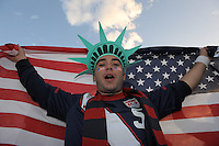 A USA fan holds up an American Flag. USA vs England in the 2010 FIFA World Cup in Rustenburg, South Africa on June 12, 2010.
