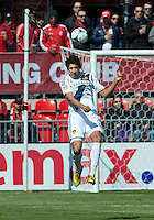30 March 2013: Los Angeles Galaxy defender Omar Gonzalez #4 in action during an MLS game between the LA Galaxy and Toronto FC at BMO Field in Toronto, Ontario Canada..The game ended in a 2-2 draw..
