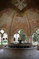 Low angle view of a fountain in an arcaded cupola in the cloister of Monestir de Poblet, 1151, Vimbodi, Catalonia, Spain, pictured on May 20, 2006, in the afternoon. The Monastery of Poblet belongs to the Cistercian Order and was founded by French monks. Originally, Cistercian architecture, like the rules of the order, was frugal. But continuous additions  including late Gothic and Baroque, eventually made Poblet one of the largest monasteries in Spain which was later used as a fortress and royal palace. It was closed in 1835 by the Spanish State but refounded in 1940 by Italian Cistercians. It is a UNESCO World Heritage Site. Picture by Manuel Cohen.