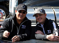 Mar 30, 2014; Las Vegas, NV, USA; NHRA top fuel driver Steve Torrence (right) with father Billy Torrence during the Summitracing.com Nationals at The Strip at Las Vegas Motor Speedway. Mandatory Credit: Mark J. Rebilas-