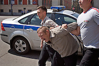 Moscow, Russia, 27/05/2007..Police arrest a nationalist demonstrator who attacked Moscow's second attempted Gay Pride parade. The parade had already been banned by Moscow Mayor Yuri Luzhkov on the grounds that it would provoke violence, but gay activists attempted to demonstrate in defiance of the ban, and many were beaten by counter demonstrators and arrested by police.