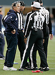 Seattle Seahawks Head Coach Pete Carroll, left, talks to Referee Jerome Boger and other officials after throwing the challenge flag in their game against the Minnesota Vikings at CenturyLink Field in Seattle, Washington on  November 4, 2012.  The Seahawks beat the Vikings 30-20.    ©2012. Jim Bryant Photo. All Rights Reserved.