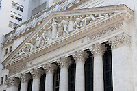 The neoclassical New York Stock Exchange on Wall Street featuring the pediment Integrity Protecting the Works of Man.