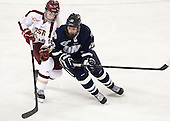 Ryan Fitzgerald (BC - 19), Dalton Speelman (UNH - 10) - The Boston College Eagles defeated the visiting University of New Hampshire Wildcats 6-2 on Friday, December 6, 2013, at Kelley Rink in Conte Forum in Chestnut Hill, Massachusetts.