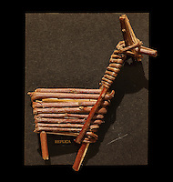Replica of a split twig animal figurine made from a single split and bent willow branch, 2900-1250 BC, at the Anasazi Heritage Center, Dolores, Colorado, USA. The figurines are from 30 sites in Arizona, Utah, Nevada, and California. Some were recovered in the debris of daily living and others were ritually cached in pits or beneath rock cairns, often with bits of animals dung, or pierced by tiny spears, apparently as hunting magic. They may represent totems, animal relatives of the people who made them. Picture by Manuel Cohen