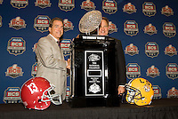 LSU Head Coach Les Miles and Alabama Head Coach Nick Saban pose together for group pictures with BCS National Championship Trophy during BCS National Championship Head Coaches Press Conference at Marriott Hotel at the Convention Center on January 8th, 2012.