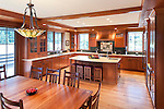Decorative tile inset, copper range hood, and Tiffany chandelier are among the unique elements of this Craftsman style kitchen. This image is available through an alternate architectural stock image agency, Collinstock located here: http://www.collinstock.com
