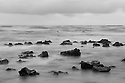 Rocks and surf, stormy sunrise near Alau Island; Hana; Maui, Hawaii.