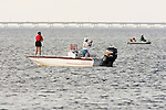 Saltwater fishing in the Laguna Madre by South Padre Island causeway, Texas