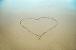 Heart drawn in the beach sand.