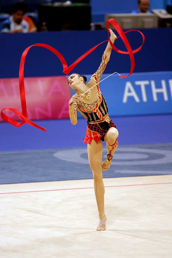 Anna Bessonova of Ukraine pivots with ribbon during qualifications round at 2004 Athens Olympic Games on August 27, 2006 at Athens, Greece. (Photo by Tom Theobald)