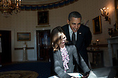"United States President Barack Obama looks over the shoulder of Hannah Wyman, 11, as she demonstrates her project in the Blue Room, February 7, 2012, during the second annual White House Science Fair celebrating student winners of science, technology, engineering, and math (STEM) competitions from across the country.  Wyman, who attends St. Anna's School in Leominster, Massachusetts, won the grand prize in her age group (9-12) for her video game ""Toxic,"" in Microsoft's first-ever U.S.  Kodu Cup.  .Mandatory Credit: Pete Souza - White House via CNP"
