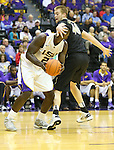 Feb 6, 2013; Baton Rouge, LA, USA; LSU Tigers forward Johnny O'Bryant III (2) is defended by Vanderbilt Commodores center Josh Henderson (40) during the second half at the Pete Maravich Assembly Center. LSU defeated Vanderbilt 57-56. Mandatory Credit: Crystal LoGiudice-USA TODAY Sports