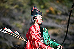 "Dressed in ornate period costume, a member of the Toyama-ryu ""yabusame"" horseback archery group rides her horse along the course during an event in Machida, western Tokyo, Japan on Nov. 28 2010. During the late Heian era (794 to 1185) and Kamakura era (1185-1333) such archery was the domain of high-ranked samurai and was used as a military training exercise to keep samurai prepared for war. .Photographer: Robert Gilhooly"