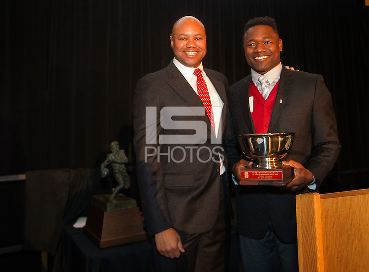 STANFORD, CA - DECEMBER 7, 2014--(L-R) Ty Montgomery, co Valuable Football Player 2014, with Stanford Football coach David Shaw, during the Football team banquet.