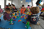 "Children play inside a ""child-friendly space"" in a refugee processing center in the Serbian village of Presevo, not far from the Macedonian border. Hundreds of thousands of refugees and migrants--including many children--have flowed through Serbia in 2015, on their way from Syria, Iraq and other countries to western Europe."