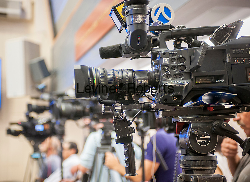 A collection of television cameras lined up at an NYPD press briefing in New York on One Police Plaza on Thursday, August 5, 2016. (© Richard B. Levine)