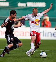 Stephen King (20) of D.C. United tries to take the ball away from Joel Lindpere (20) of the New York Red Bulls at RFK Stadium in Washington, DC.  The New York Red Bulls defeated D.CC United, 2-0.
