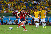 James Rodriguez of Colombia scores a goal from a penalty to make the score 2-1