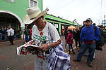 An elderly man reads a newspapaer while attending the National Convention against the imposition of Enrique Pena Nieto in San Salvador Atenco, Mexico state, July 14, 2012. More than two thousand people from twenty five states attended the Convention to plan actions in order to prevent Pena Nieto to take office on December 1, 2012 as they accuse him from buying ballots and money laundering during the elections . Photo by Heriberto Rodriguez