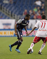 New England Revolution midfielder Sainey Nyassi (14) on the attack as New York Red Bulls midfielder Danleigh Borman (11) defends. The New England Revolution defeated the New York Red Bulls, 3-2, at Gillette Stadium on May 29, 2010.